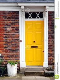 yellow brick house red door. yellow door brick house red d