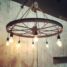 wagon wheel chandelier wagon wheel chandelier wagon wheel mason jar chandelier diy