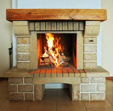 brick fireplace with massive wood mantel