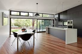 kitchen sliding door design kitchen contemporary with clerestory windows full height cabinets black pendant light