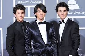 relive the highs and lows of the jonas brothers career breakup makeup and more