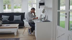 free home office. Candid Shot Of Successful Man Working In Modern Home Office Study On Laptop Computer - 4K Free