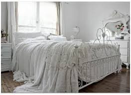 Interactive Picture Of Vintage White Chic Bedroom Decoration Using Curved Wrought Iron King Bed Frame Including Flare Lace Bedsheet And