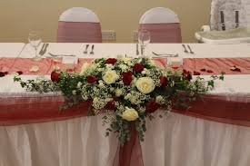 top table flower arrangement with white roses red roses gypsophila green hyperi