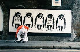 Banksy's Former Dealer Is Releasing a Book of Never-Before-Seen Photos of  the Street Artist in Action. See Highlights Here