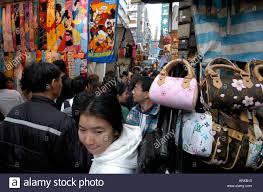 Photo Fake Past Crowds Alamy Ladies Through Designer People Of 3009298 - Walking Market Stock