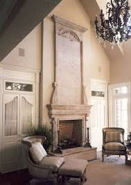 Limestone Fireplace with Tall Over Mantle mediterranean-family-room