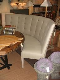 perfect cream leather curved banquette bench with tufted backseat and rustic round breakfast nook in midcentury