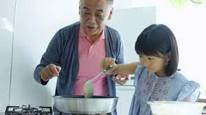 Old Man Young Girl Kitchen