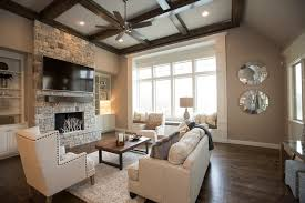 living room with stone fireplace. traditional living room design with natural stone fireplace and tv on different walls using ceiling fan e