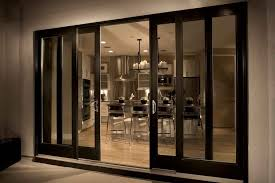 elegant black wooden frame sliding glass door with metal handle also clear glass panels plus luxurious interior view