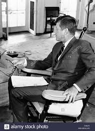 jfk in oval office. President John Kennedy In His Oval Office Rocking Chair. The Chair Relieved Tension JFK\u0027s Injured Lower Back By Keeping Jfk I