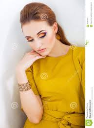 beautiful with make up wearing long yellow dress stock image image of gold