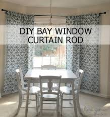 decorate a al with bold curtains and a diy bay window curtain rod