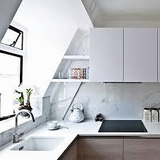 kitchen splashback created using carrara marble effect ultra thin porcelain tiles from the ferrara tile