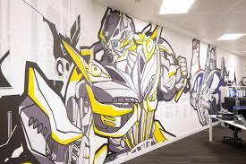 office graffiti wall. office interior design hasbro graffiti mural art toy wall