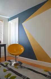 geometric wall paintFrom runway fashion to company branding kaleidoscopic designs are