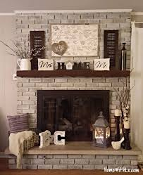 love the whitewashed brick stone slab on the hearth and wooden beam mantel how i updated our fireplace by painting the outdated brass cover and used