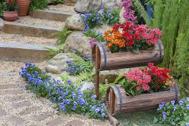 Outdoor steps with small tiered barrel flower planters