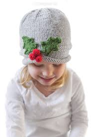 Learn how to work this pretty knit leaf pattern by watching this video tutorial! Jolly Holly Hat Knitting Pattern Little Red Window