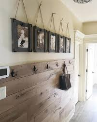 an entryway clad with stained pallet wood gets a rustic touch automatically