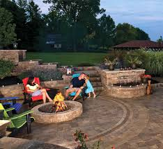 A patio firepit and water feature with Unilocks Brussels Block