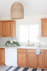 tips and tricks to update dated oak kitchen cabinets without painting them make your oak