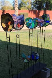stained glass with an accent glass bubble beautiful blend of aqua turquoise mint yellow blue greens purple with a splash of red