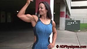 Mature feminine bicep flexing