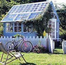 simple greenhouse made from old windows i love the red