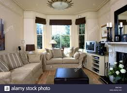 The Bay Living Room Furniture Beige Sofas In Cream Living Room With Black Blinds On Bay Window