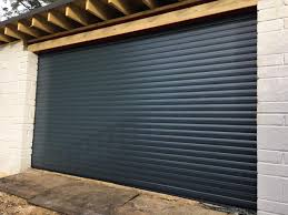 roller doors travel vertically forming a compact coil above the opening meaning minimum space requirements both inside and out
