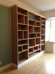 wall with mdf bookcase units built