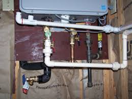 rheem indoor tankless water heater. both the tankless unit and air-intake require condensation drains. rheem indoor water heater h