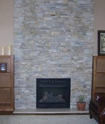 Simple Stone Veneer Fireplace Design Featuring Wooden Shelves