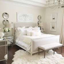 bedroom off white rugs light gray four poster bed with twirly post cerulean blue wallpaint