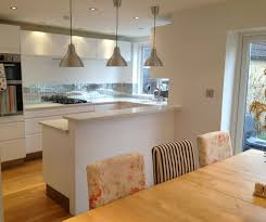 kitchen dining lighting ideas. white gloss kitchen diner lights over work top dining lighting ideas n