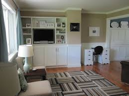 furniture white desk with drawers and black chair on wooden floor