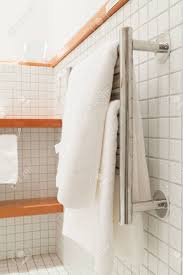 white bath towels. Stock Photo - Two White Bath Towels Hanging On A Silver Towel Rack