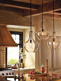 glamorous lighting in kitchen farmhouse with clear glass pendants next to light fixture alongside single bulb