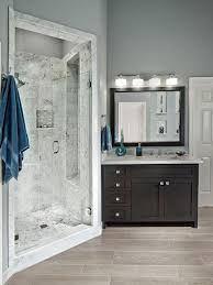 example of a transitional gray tile alcove shower design in dallas with an undermount sink