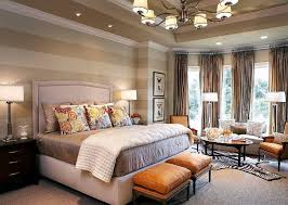 Traditional bedroom with striped walls.