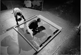 andy warhol and gerard malanga silkscreening the background onto a flowers painting