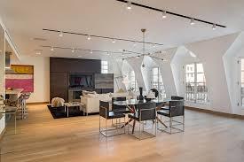 black track lighting. Track Lighting Living Room With Cream Upholstery Sofa Square Side Table On Black Rug In Minimalist