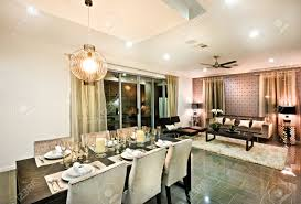 dinner table lighting. Modern Dining Area With Chairs And Glasses Under Hanging Light Flashing Over The Dinner Table Lighting E