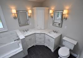 custom master bathroom with double corner vanity tower cabinet wall sconces toilet