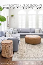looking to increase seating in a small living space this light bright living room is