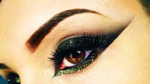 y black gold cat eye with glitter make up using makeupgeek lit cosmetics arabic style you