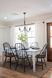 joanna gaines designed white table and black chairs