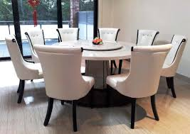 marble top round dining table and 8 chairs with sliding glass doors